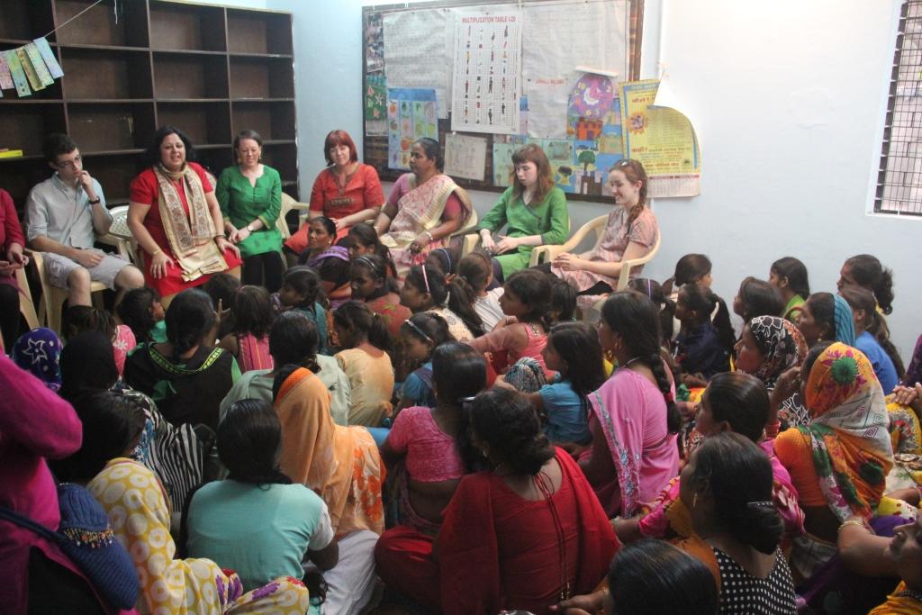 Dr Kiran facilitates an interaction between the Wallace High School team and the Asha community at Mayapuri slum colony