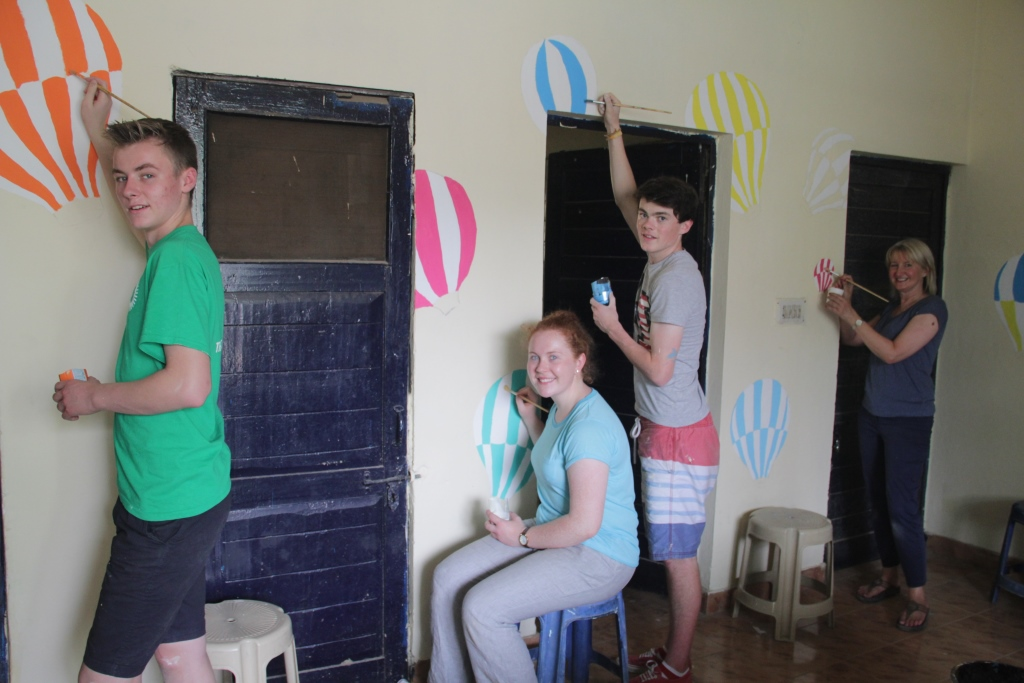 Students and teacher, Pearl Donnelly (far right) painting the Asha centre at Kusumpur slum colony