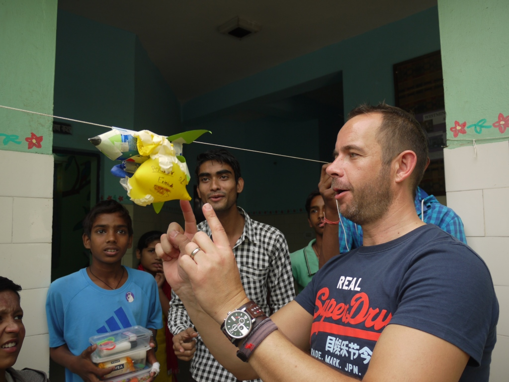 Headmaster David Briggs leads a science workshop for children group in Seelampur