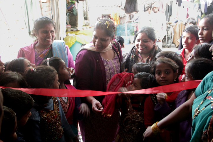 Ms Kiran Gera being welcomed by the kids before she cut the ceremonial ribbon