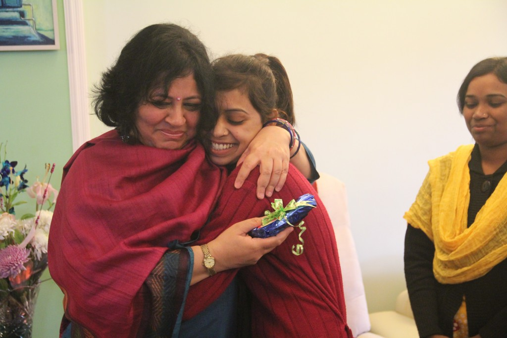 Dr Kiran, overcome with emotion, hugs a student after she presented her with a Christmas gift