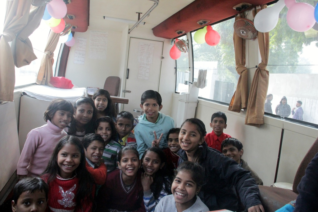 Excited Bal mandal children from Asha's Mobile Healthcare Bus areas just before the celebration began.