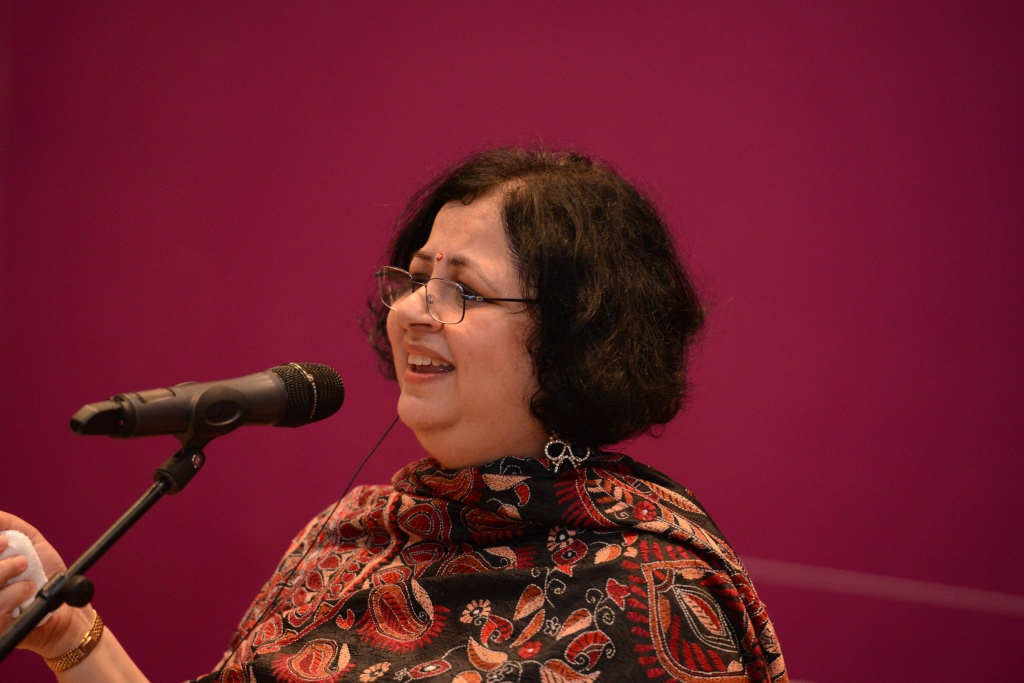 Dr Kiran singing at the concert