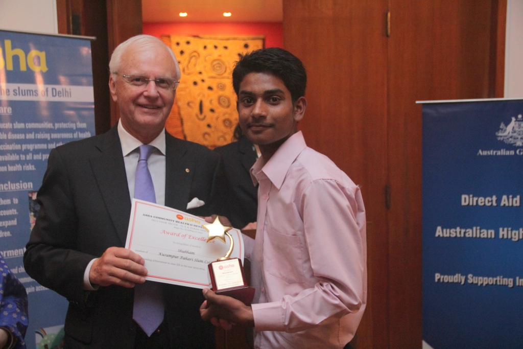 Shubham receives the class 12 topper of the award