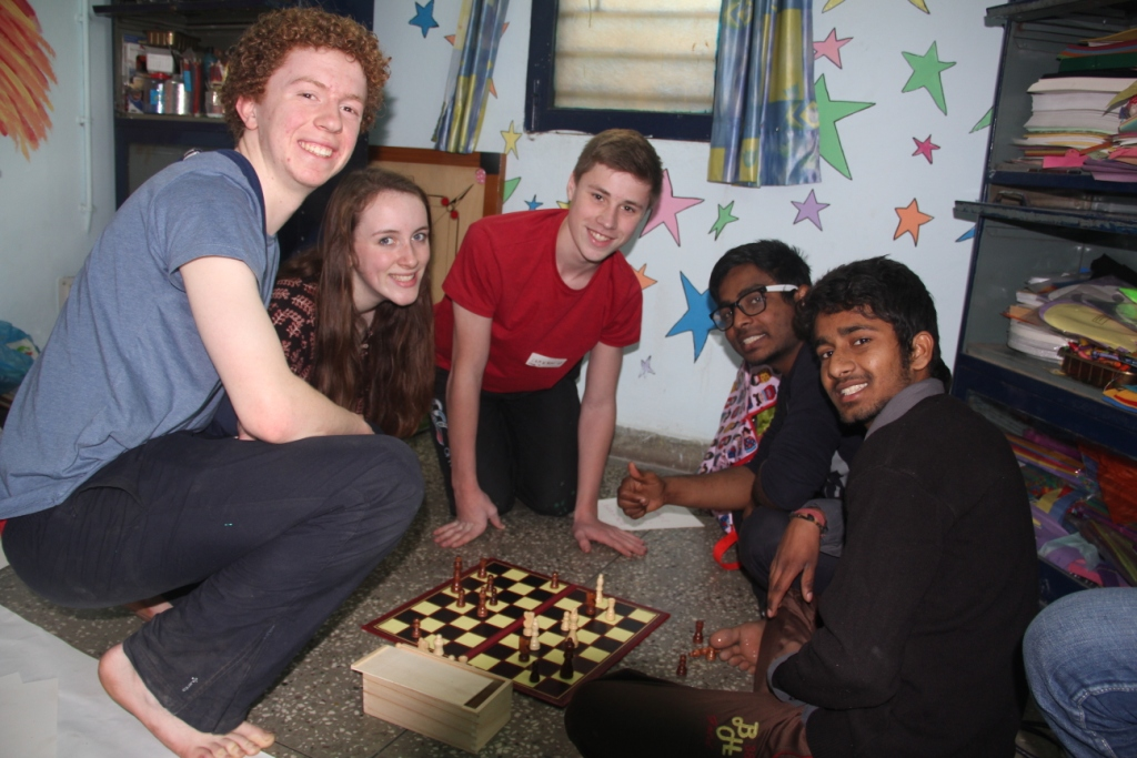 The team playing chess with students