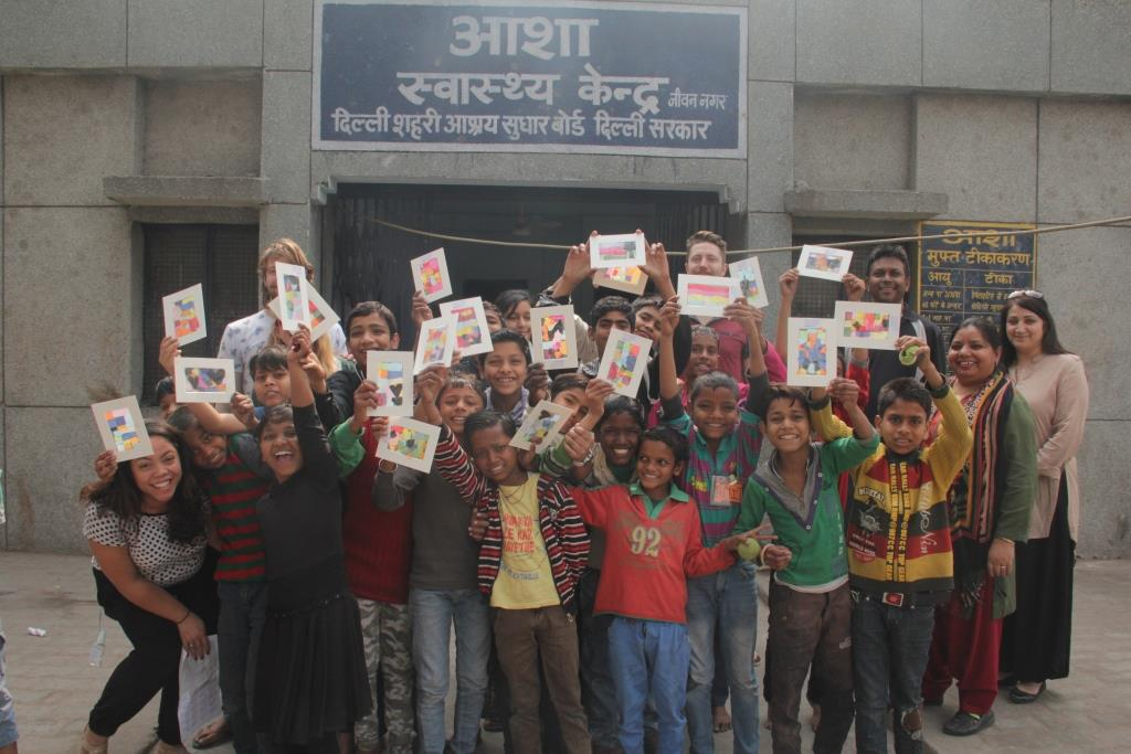 Members of City Life Church and Jeevan Nagar kids pose for a photo with their craft work