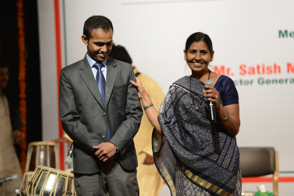 Mahinder with his mother, Smt Rani while addressing the audience