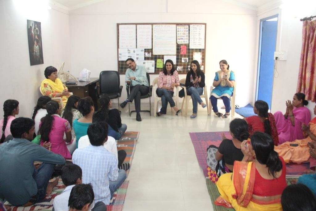 Mr Anoop Kapoor, Ms Richa Arora and Ms Jyoti Dhir with Ms Kiran Gera interacting with the students at  Kanakdurga center