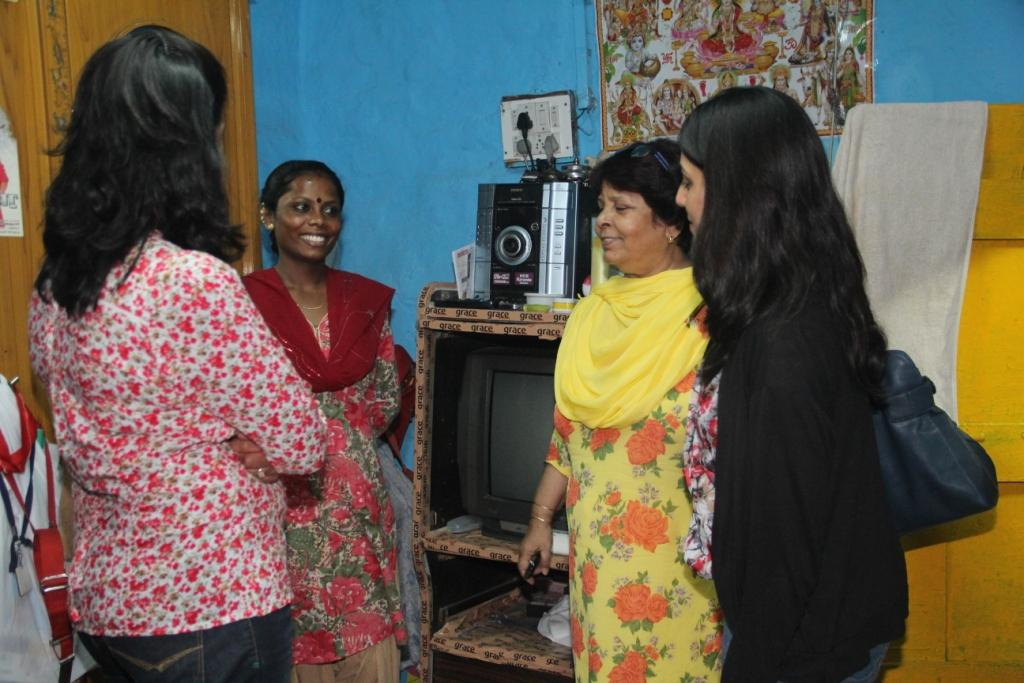 Ms Arora and Ms Dhir interacting with a community woman