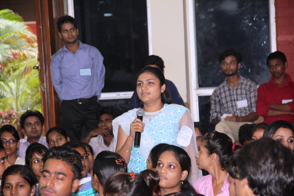 An Asha student asking a question to the Panel about selecting Hotel Management as a career