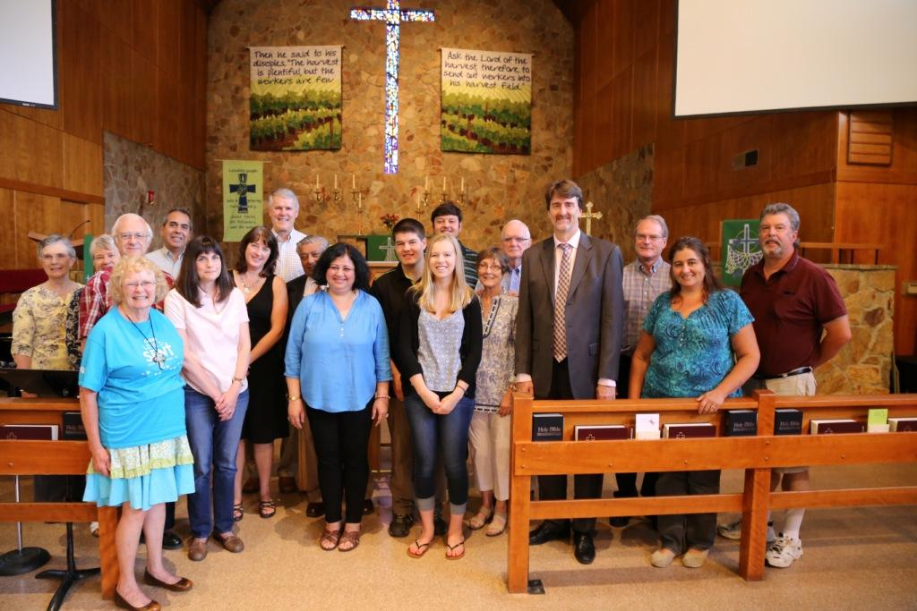 Dr Kiran with Pastor Mike and members of the congregation