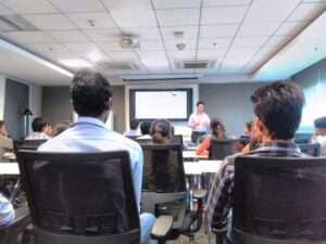 Macquarie team member discussing tips for resume writing, with Asha students