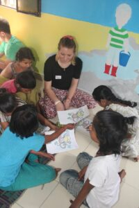 The volunteer teams conducting art and craft activities