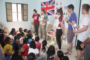 Royal school students teaching Asha children