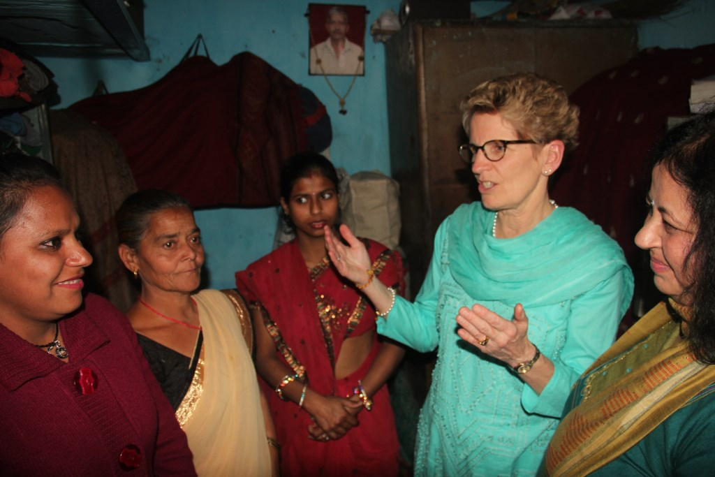 Hon. Kathleen visiting a slum resident's home with Dr Kiran
