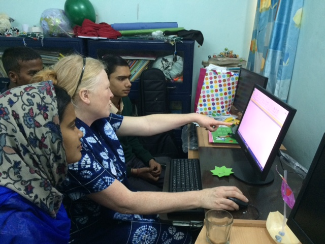Gwen teaching computers to high school children