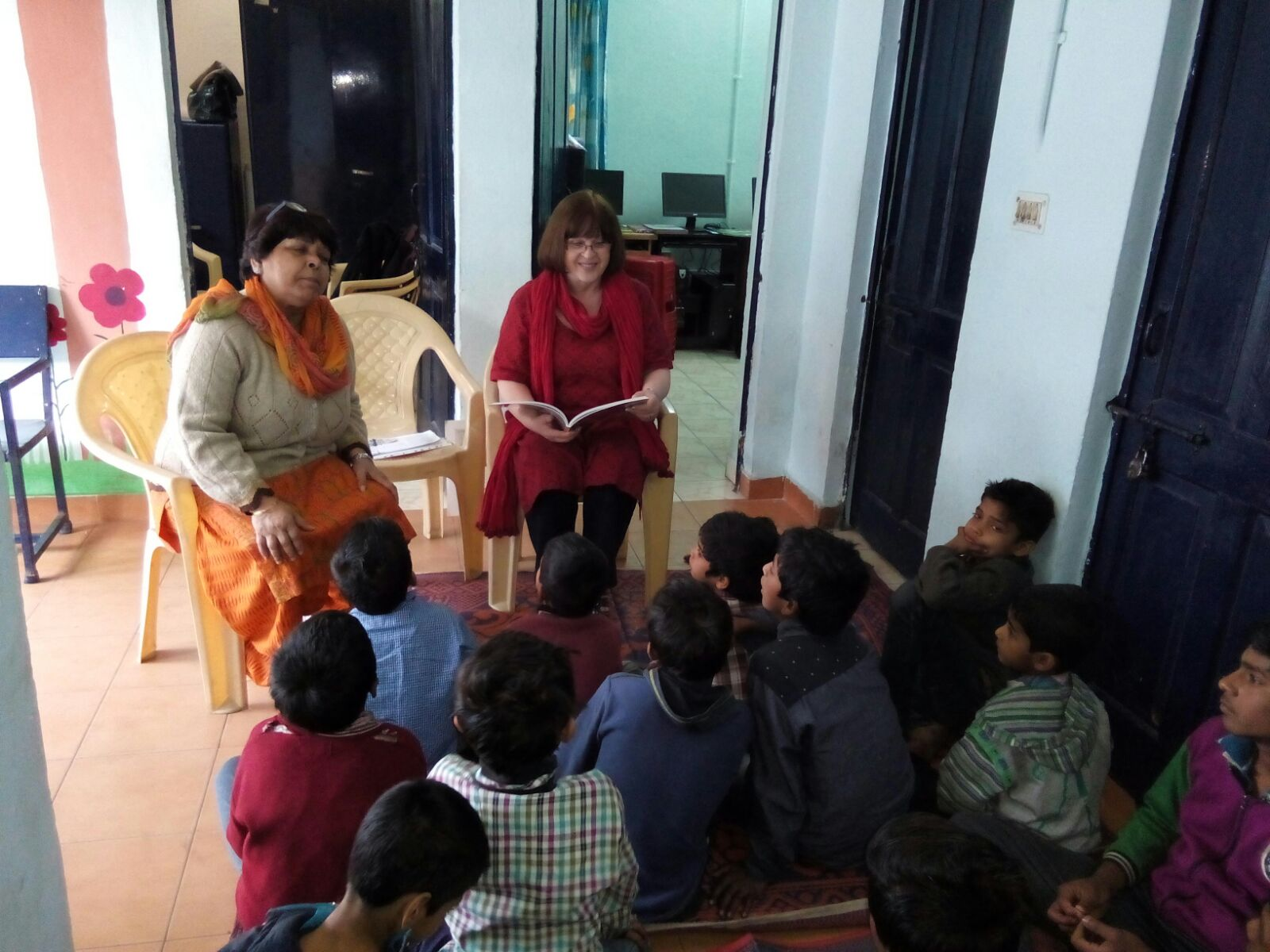 Jenny from the team narrating a story to the younger children at Zakhira slum colony