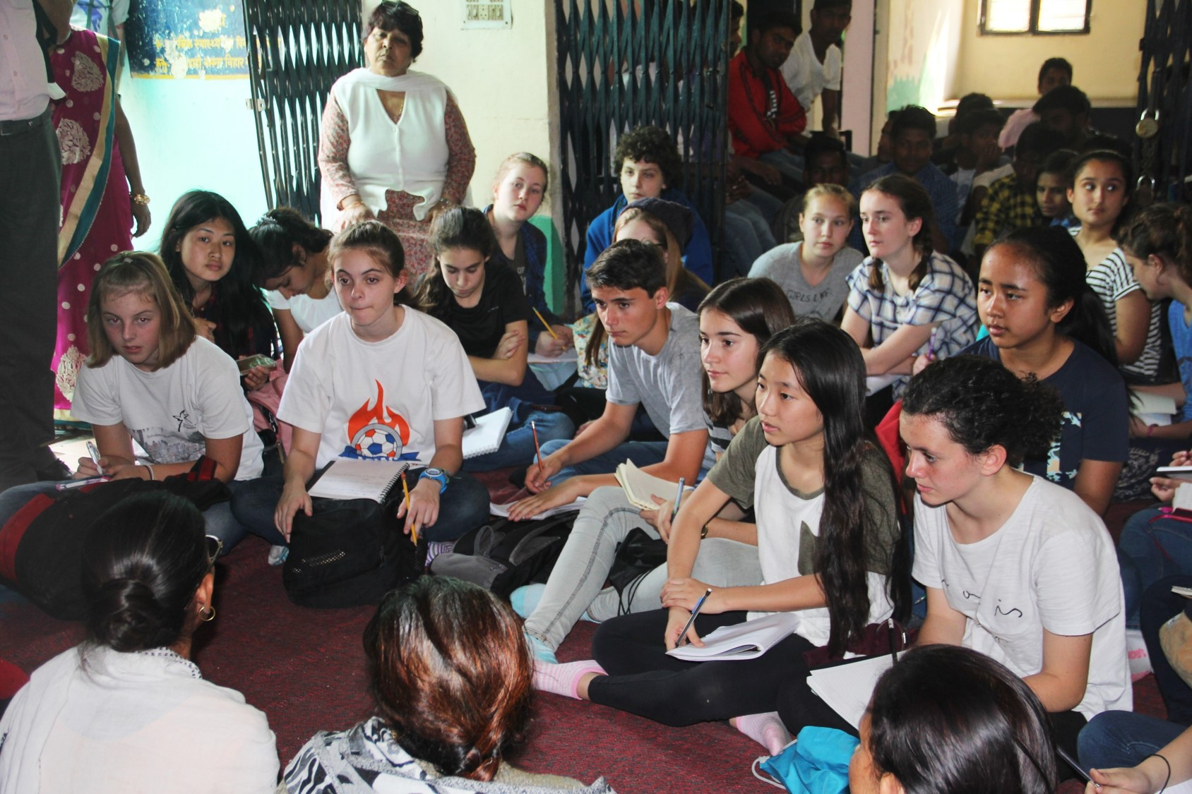 The students seeking answers from the Present of Women's Association