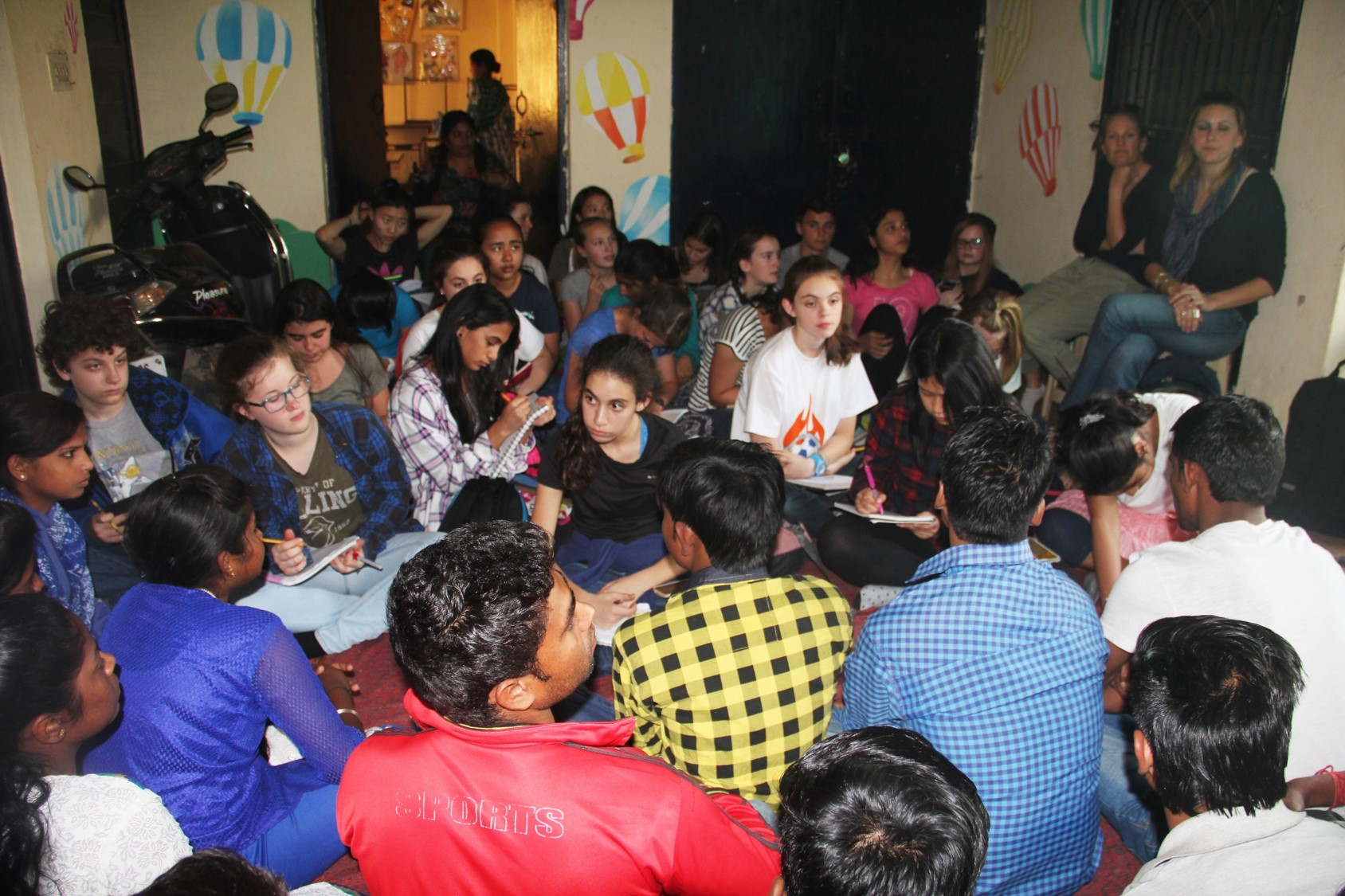 The students from American Embassy School asking questions during their interaction with the Asha College students