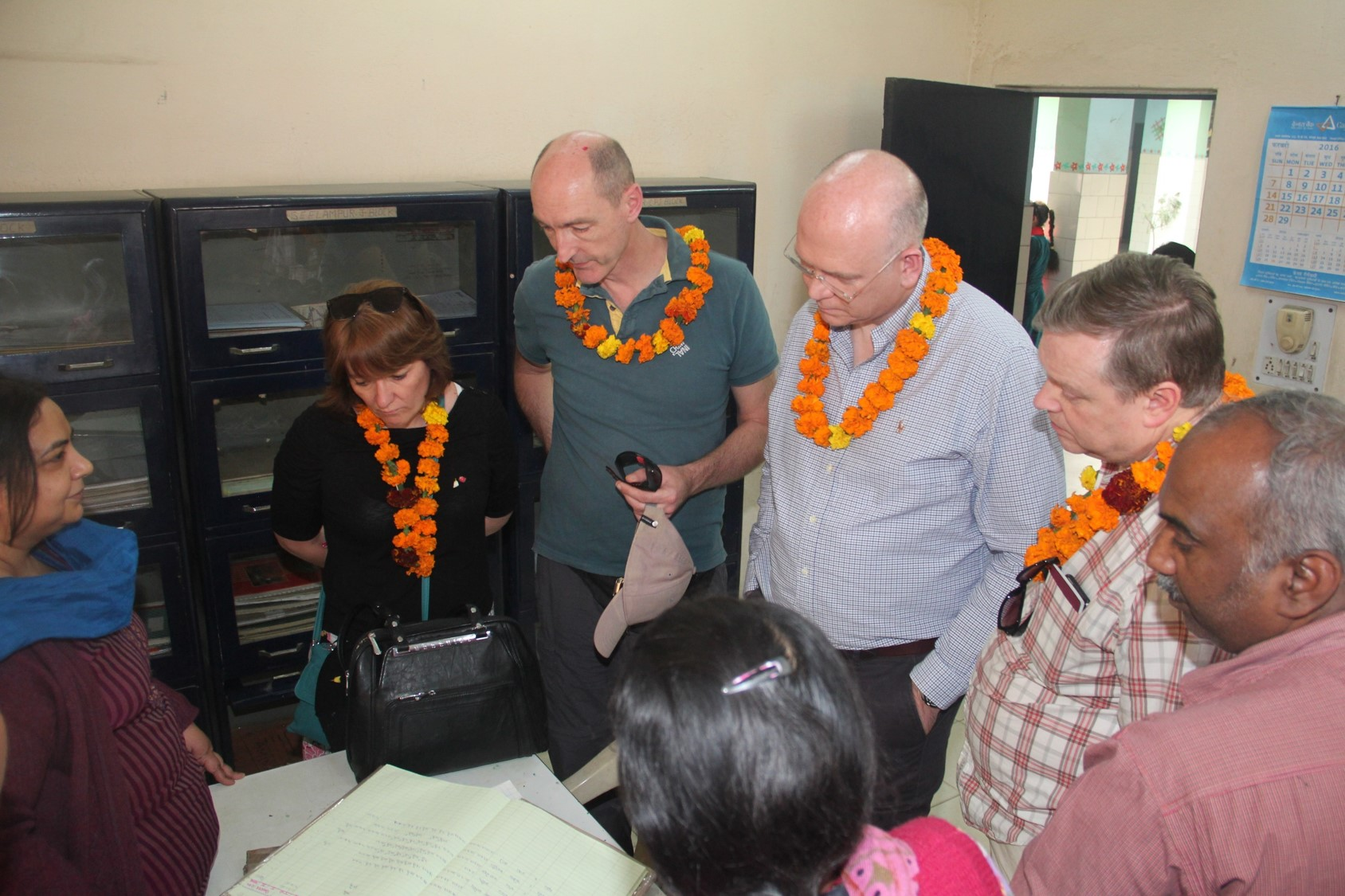 The Asha team showcasing the record keeping system at our slum based centres.