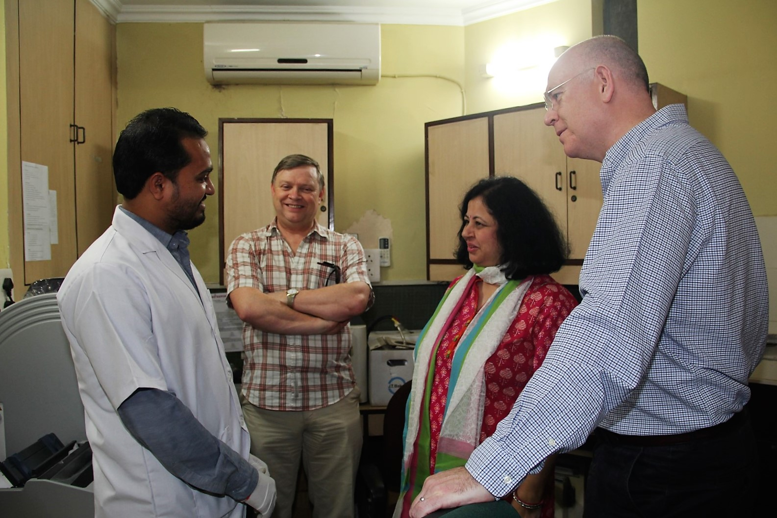 Colin and Stephen interacting with the Asha Polyclinic team.