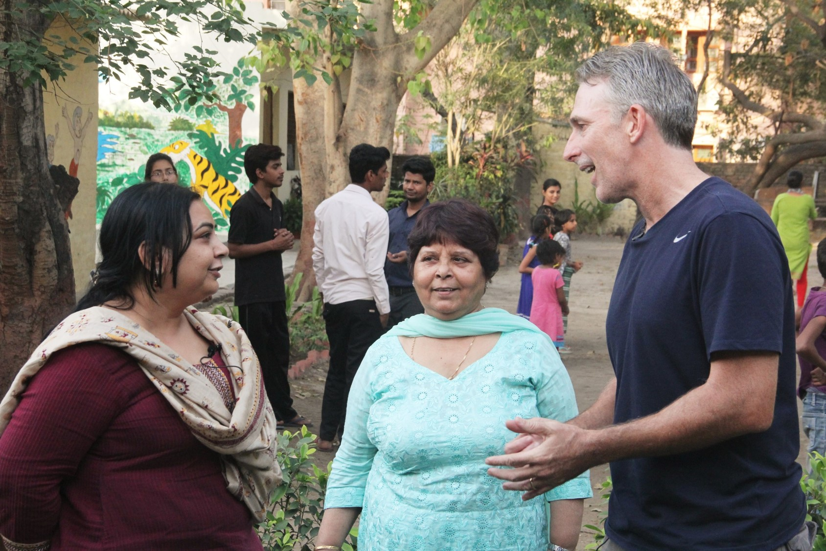 Damien interacting with the Asha team members.