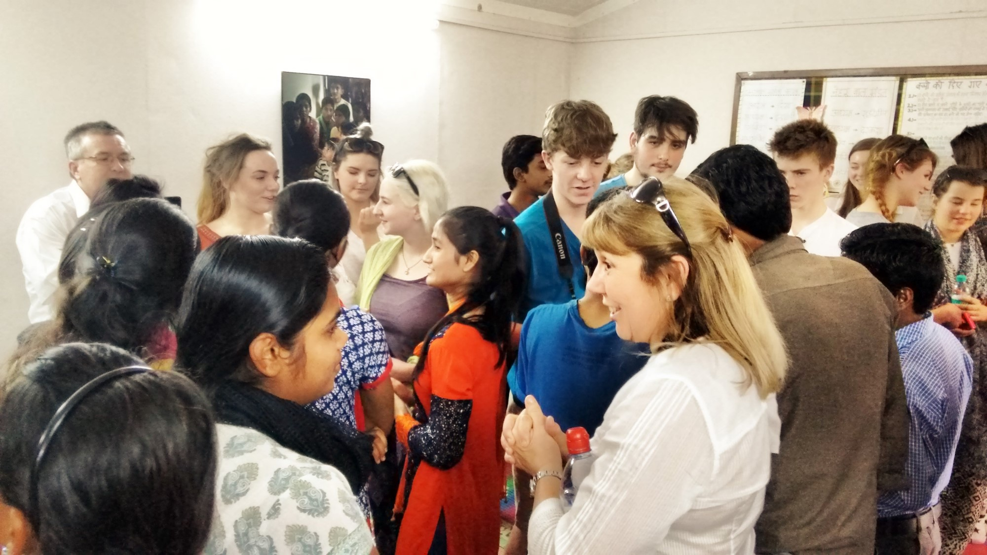 The students interacting with Asha's school and college children