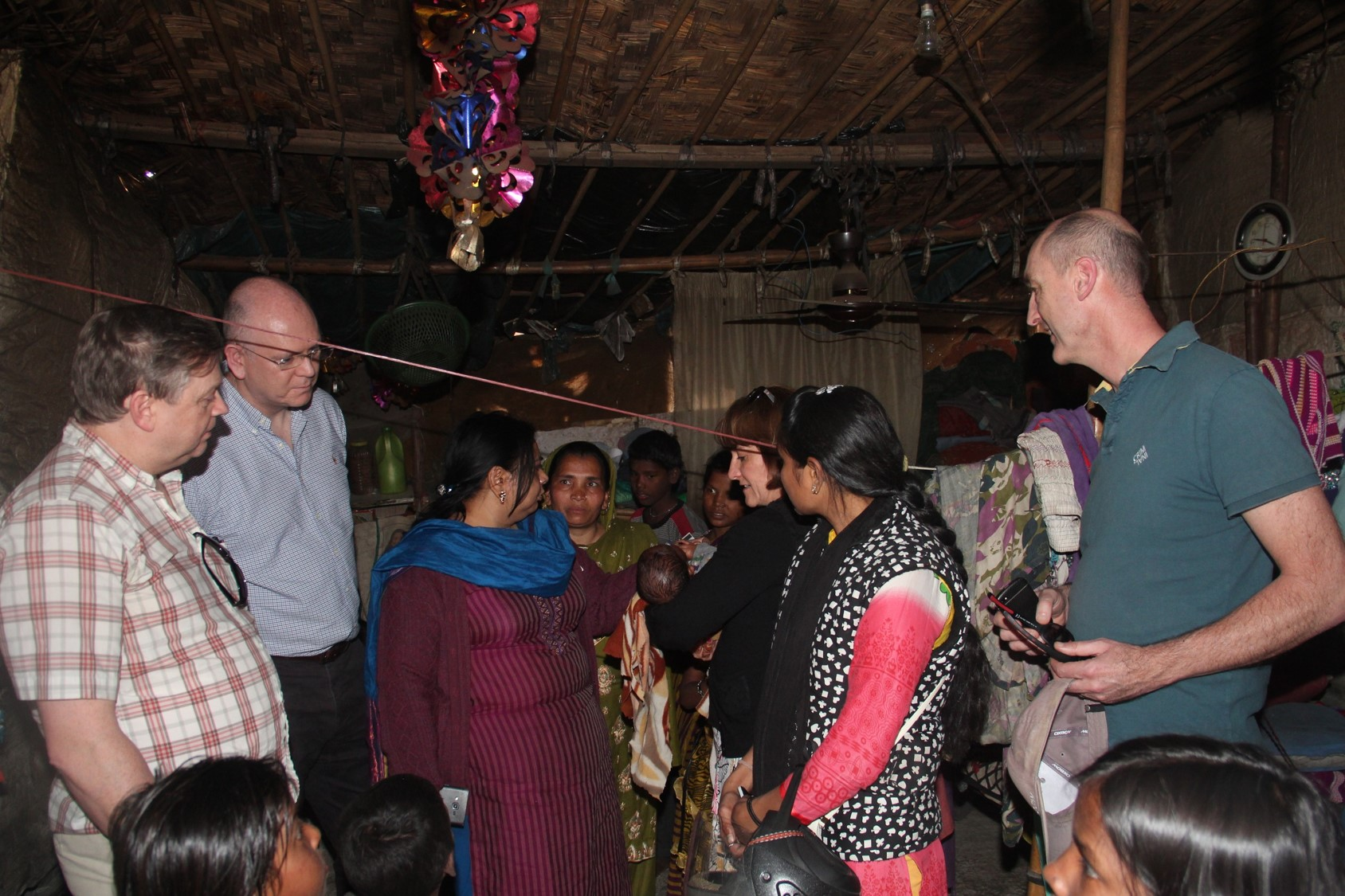 The visitors getting to know about the lives of slum dwellers, during a house visit at Seelampur.