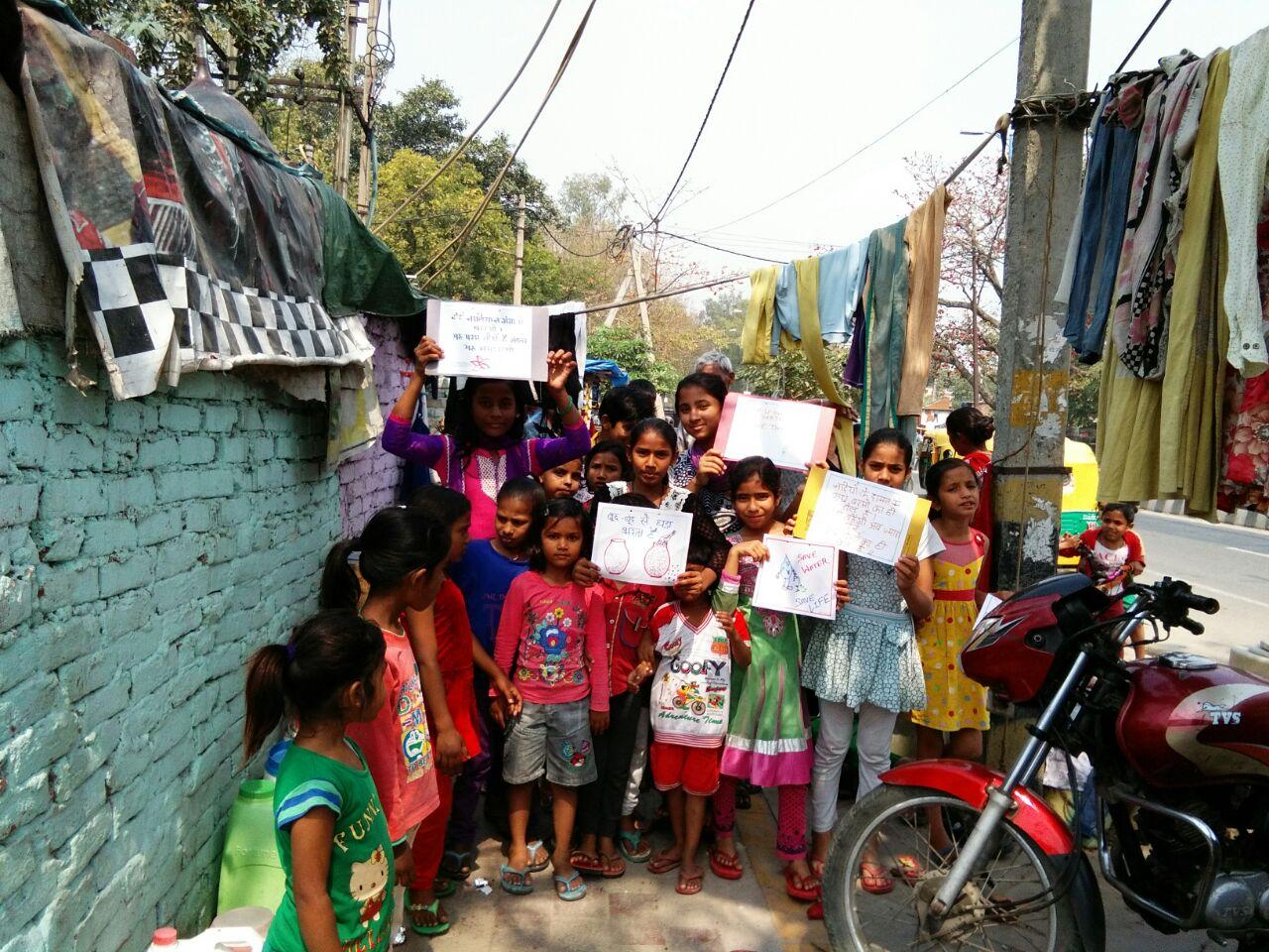 The Mobile Health Van area children voicing slogans in their slum
