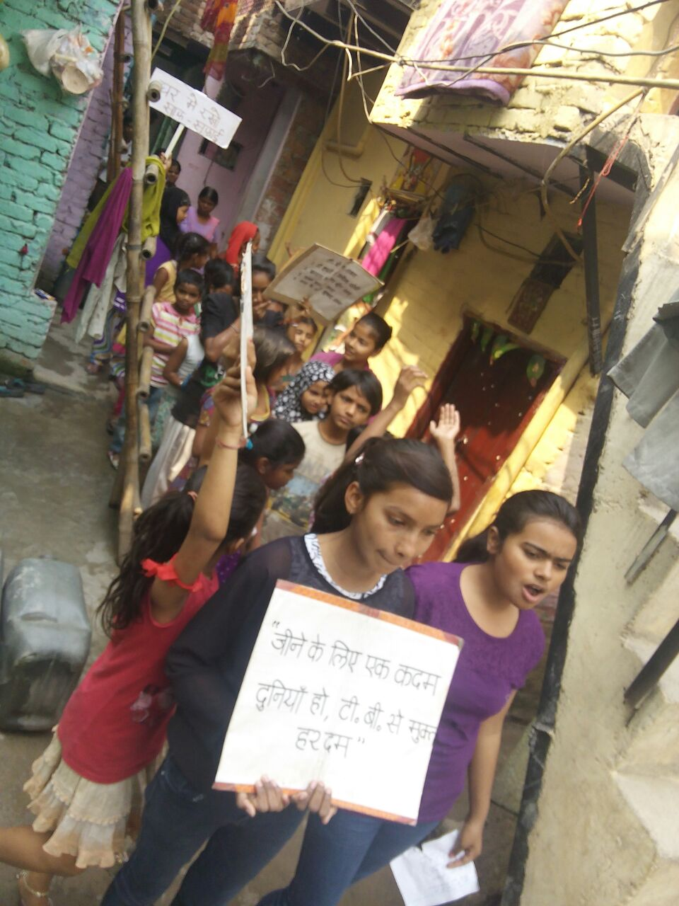 Children from Trilokpuri slum colony carrying out an awareness rally