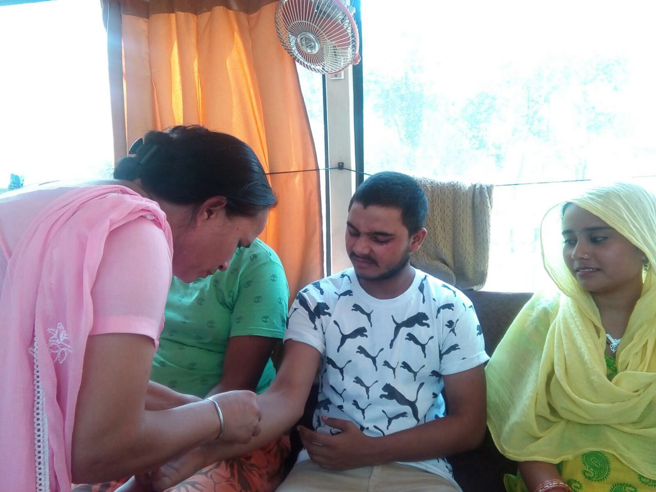 An Asha Nurse collecting blood samples of the suspected patients