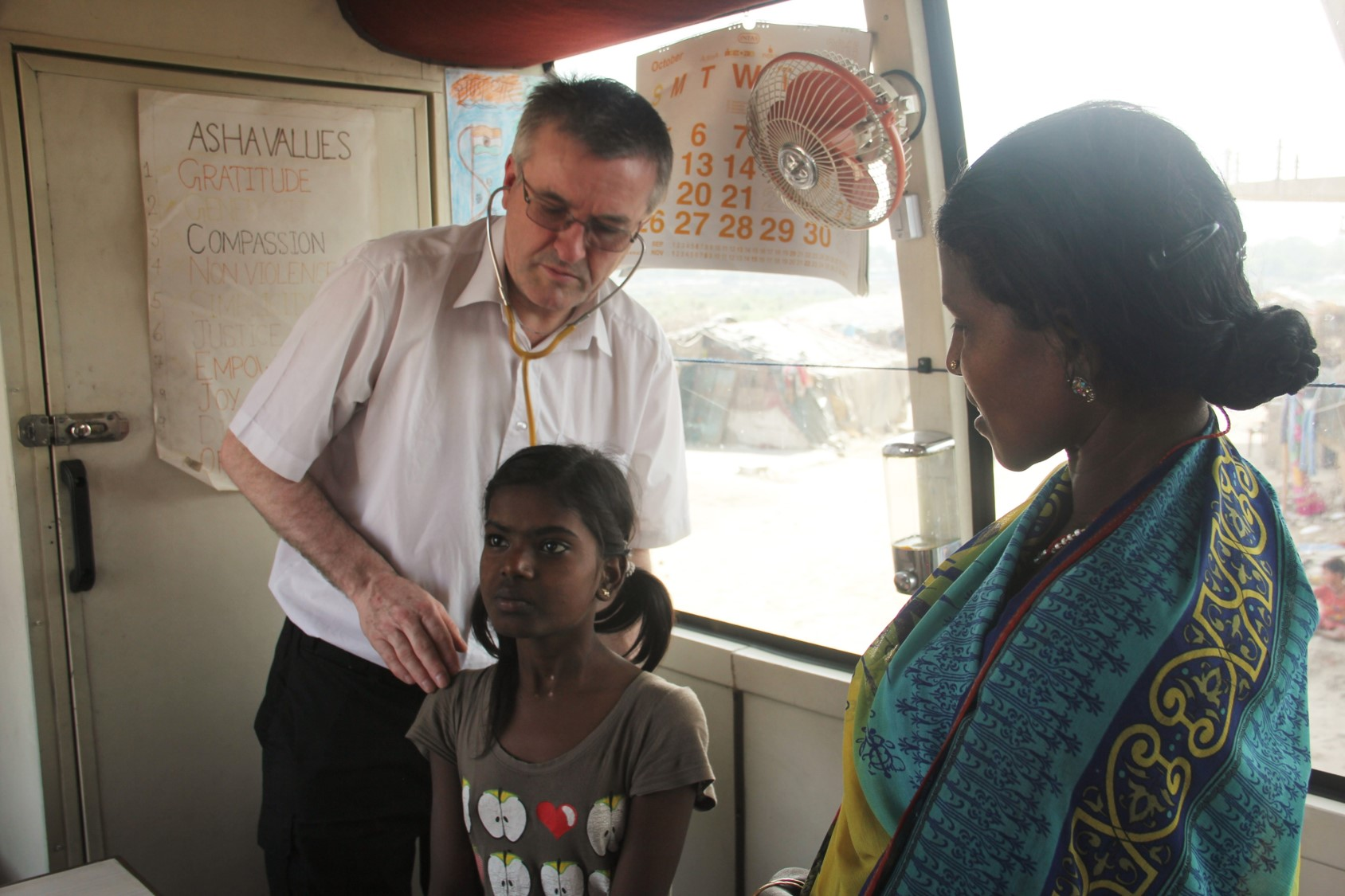 Dr Dick examining a patient at Seelampur slum colony