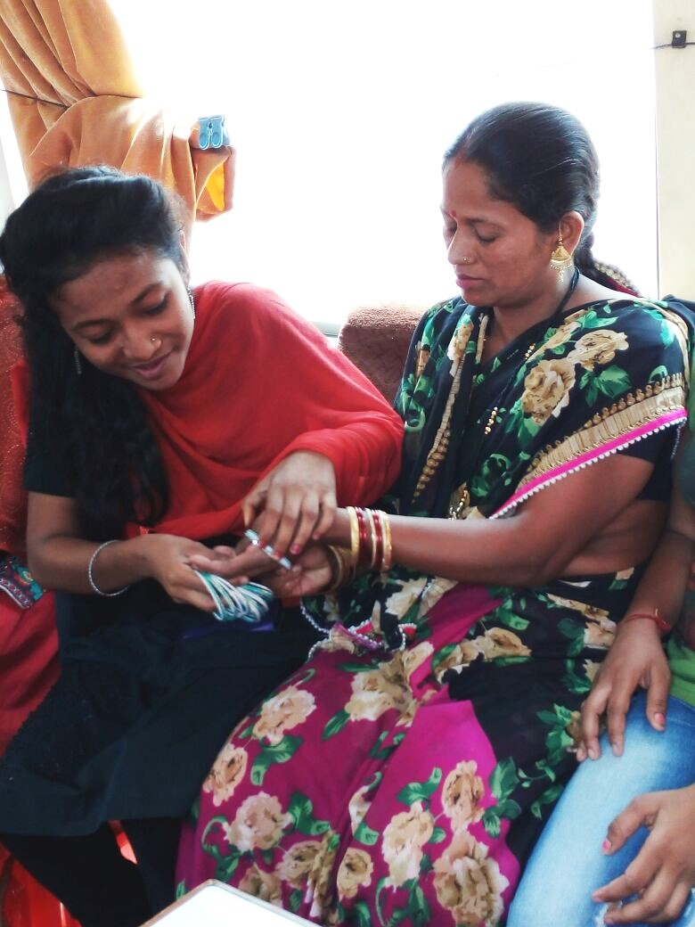 One of the girls presenting a gift to her mother
