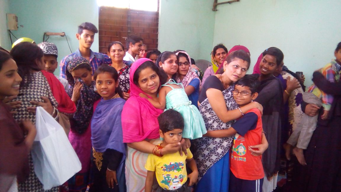 Women and children at Seelampur slum colony