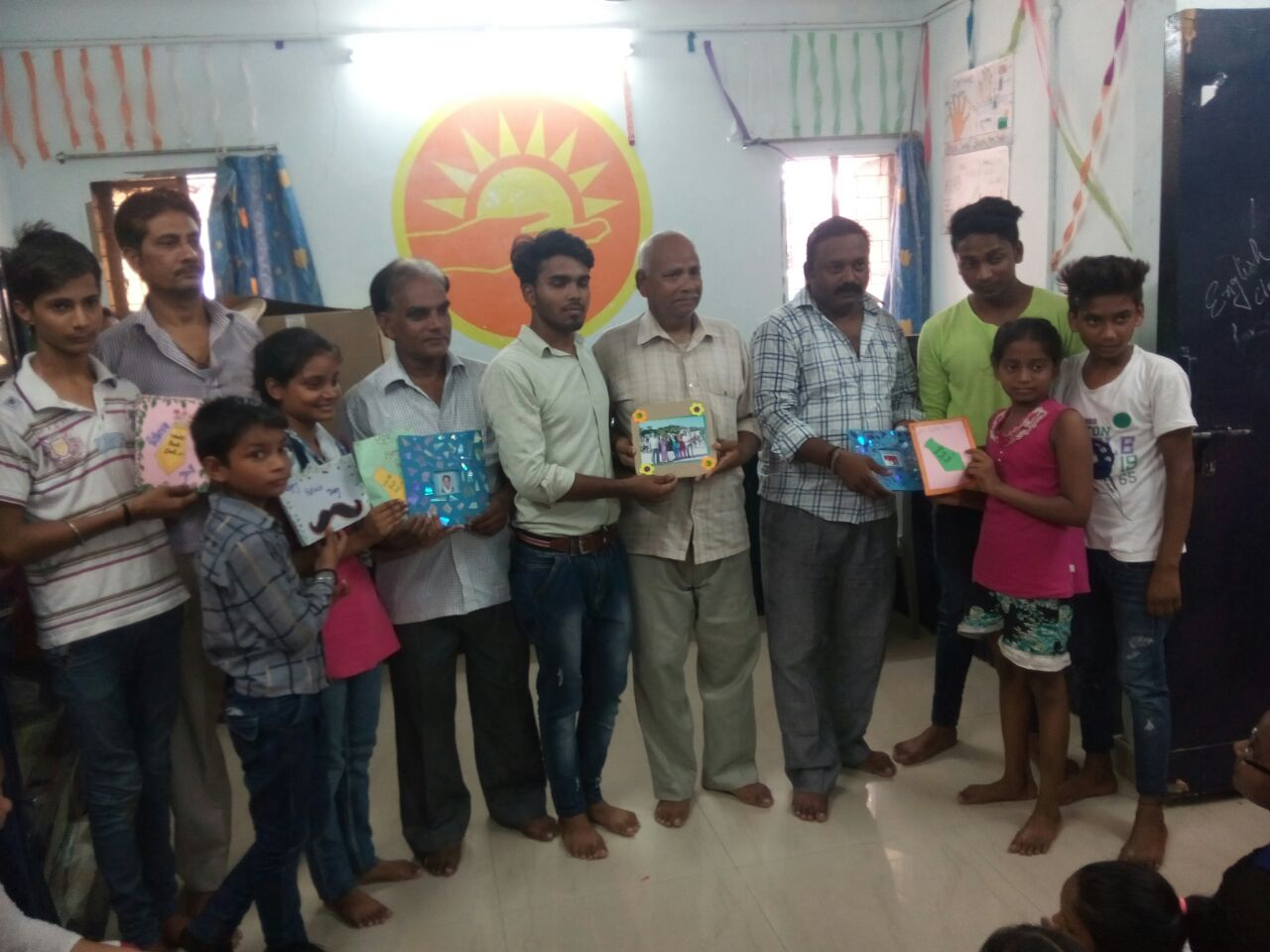 Children presenting handmade cards to their fathers.