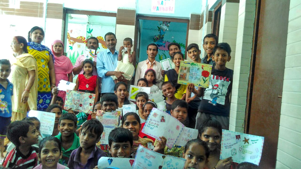 Celebration at Jeewan Nagar, with the children showcasing handmade cards.