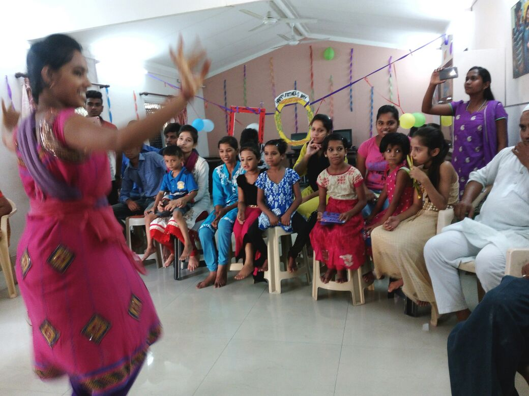 A student performing a dance at Kanak Durga slum colony.