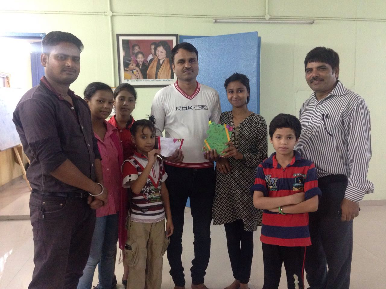 Team Leader David with Asha students and their parents during the celebration at Peeragarhi.