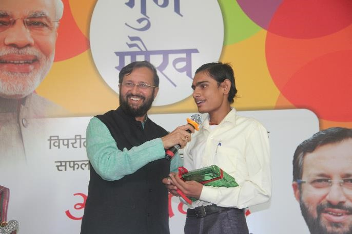 The minister praised Santosh from Zakhira slum community for scoring an amazing 88%, despite his hearing impairment.