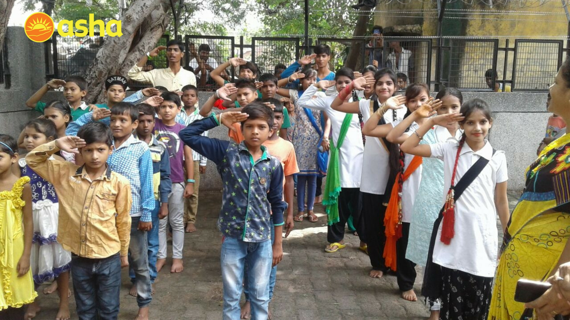 Asha students saluting with pride at Jeewan Nagar.