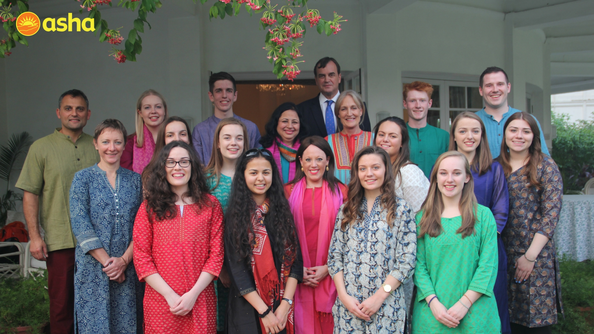 The Honourable Sir Dominic Asquith and Lady Asquith along with Dr. Kiran posing for a group picture with Wallace High School, Northern Ireland.