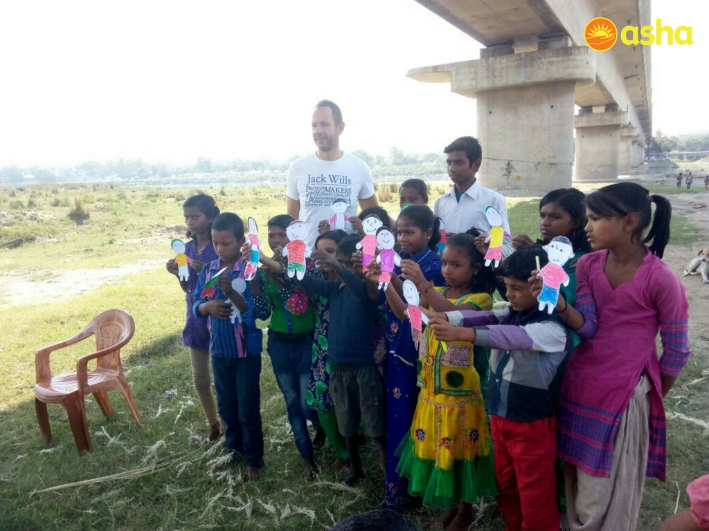 The children with their handicrafts, along with David Briggs, posing for a picture at the new area.
