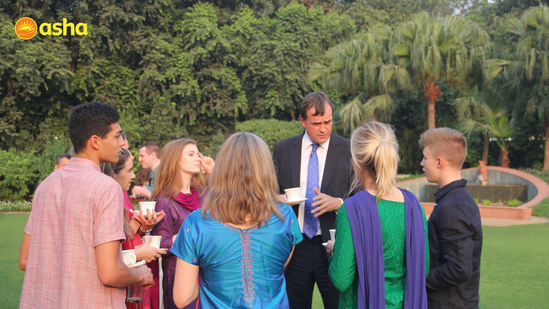 The Honourable Sir Dominic Asquith KCMG engaged in a discussion with one of the teams from UK.