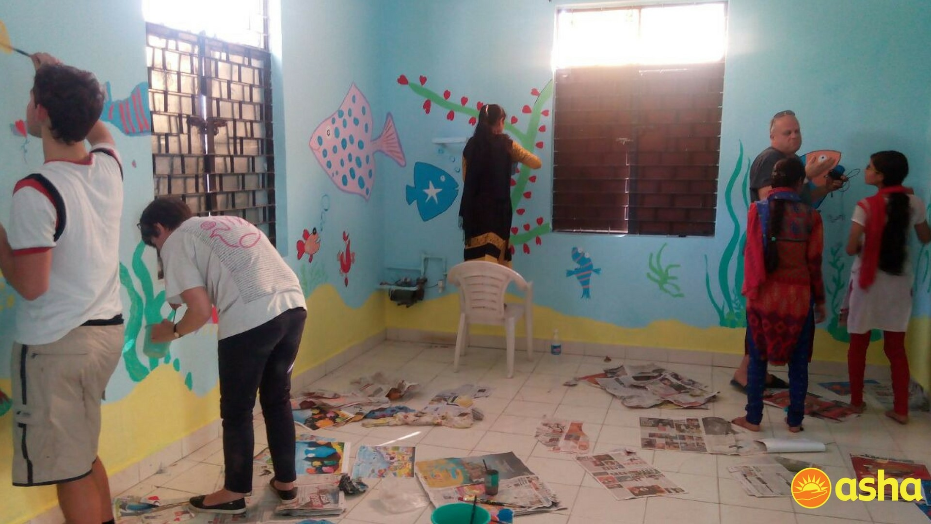 The team painting murals at Seelampur centre.