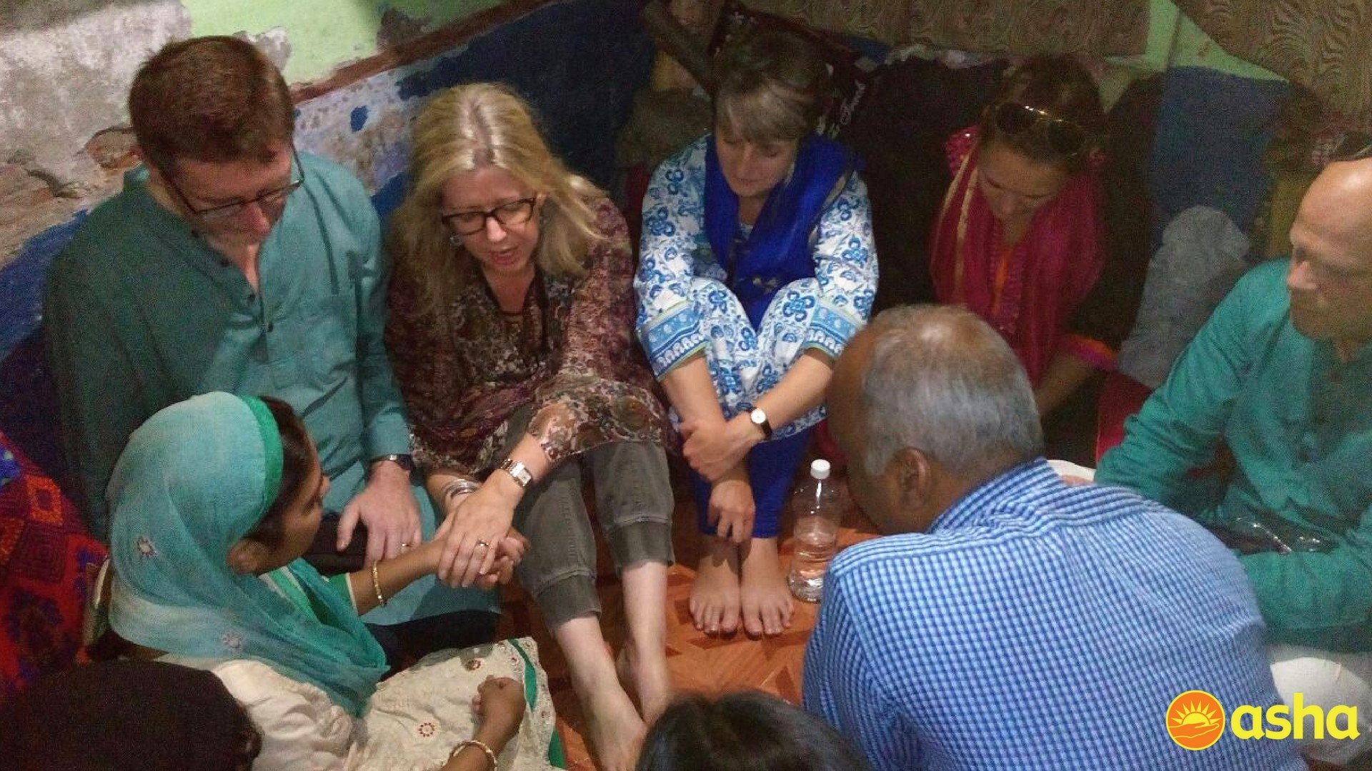 The team during a prayer session at a slum dweller's house.