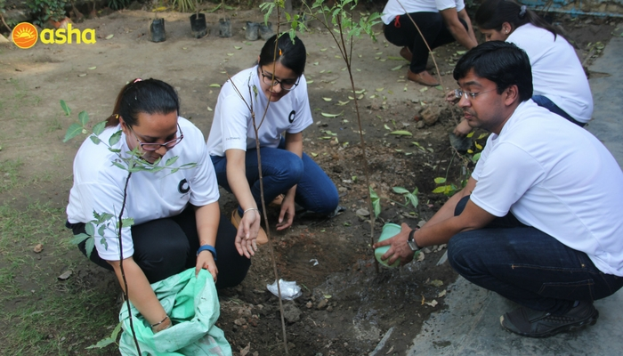 Tree Plantation drive taking place at the Kanak Durga slum community.