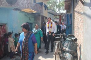 Mathew Canavan walking through the community to witness life at slums, first hand.