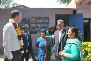 Australian Senator, Mathew Canavan, and Australia India Business Council's President Nik Senapati interacting with the Asha Team