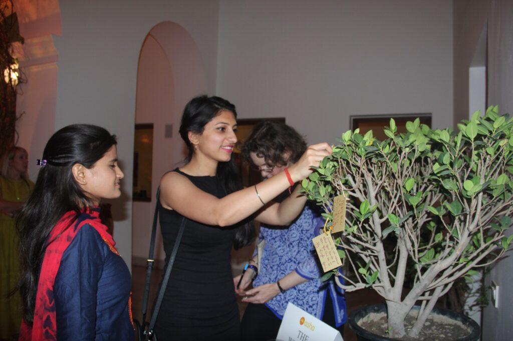 Yamini Arora from Mazars Gurgaon tying a wish on 'The Wishing Tree',