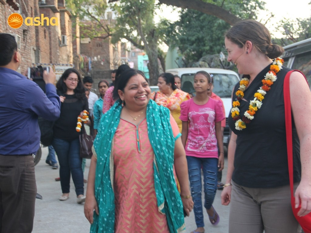 Susan Clear interacting with Asha Supervisor, Sweeta Jacob, as they walk through the community